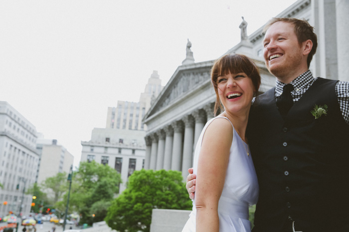 bride and groom in front of New York City Hall