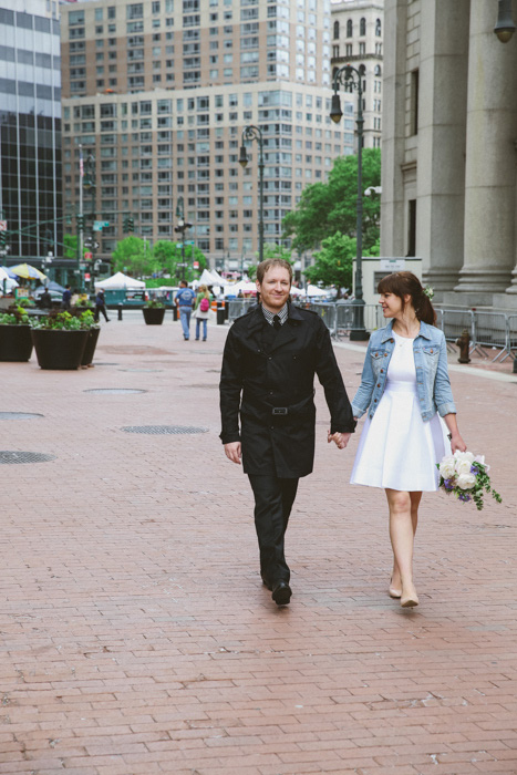 bride and groom strolling through New York