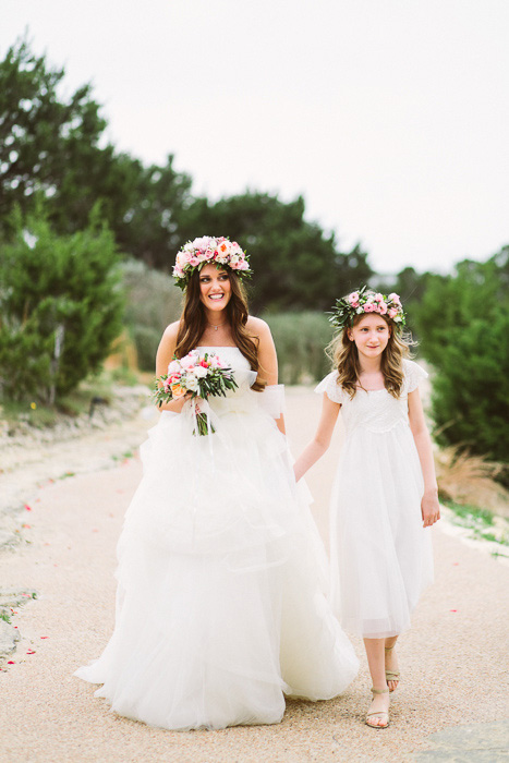 bride walking with flower girl