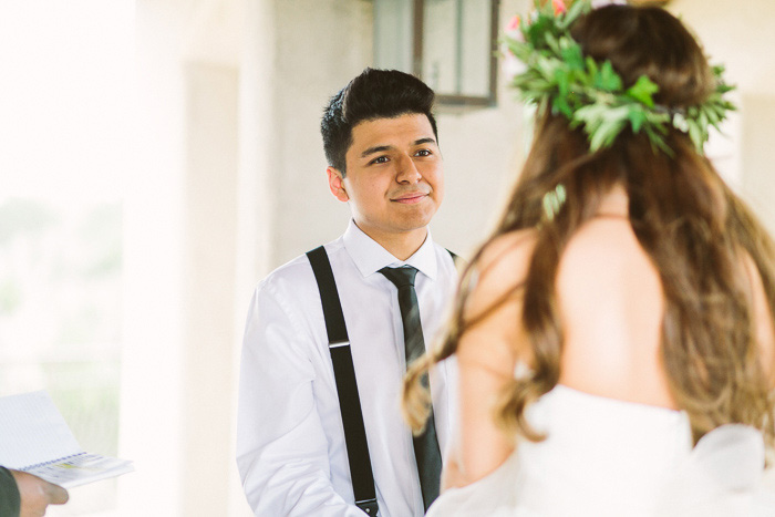 groom smiling lovingly at his brde