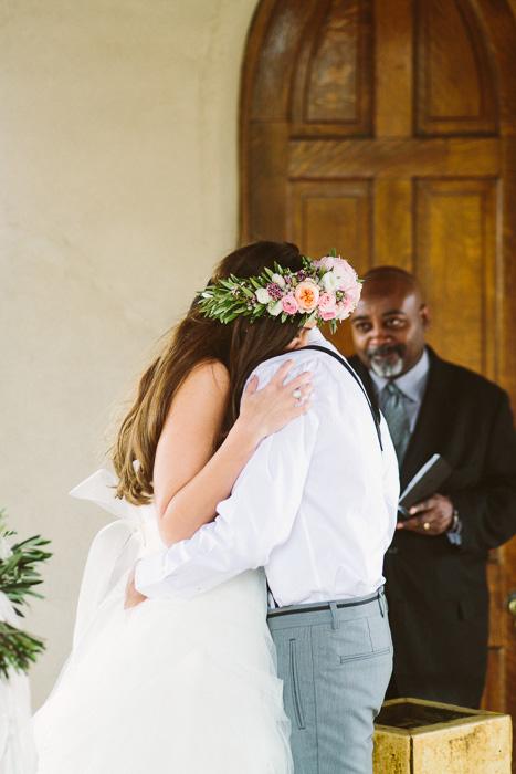 bride and groom hugging at wedding ceremony