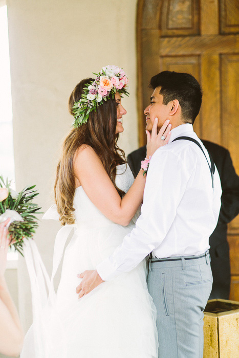 happy bride and groom at the altar