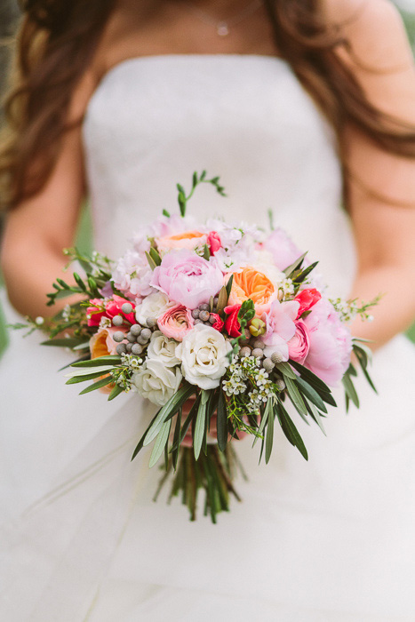 bride with pink garden rose bouquet