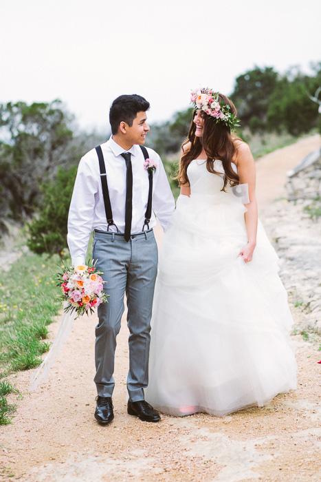 bride and groom walking along dirt road