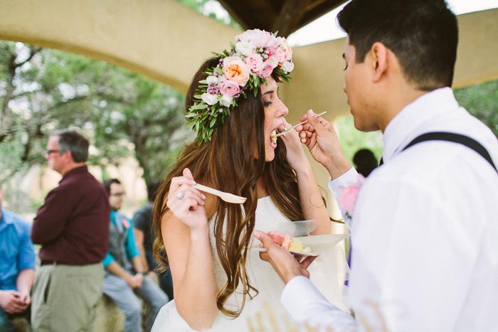groom feeding bride cake