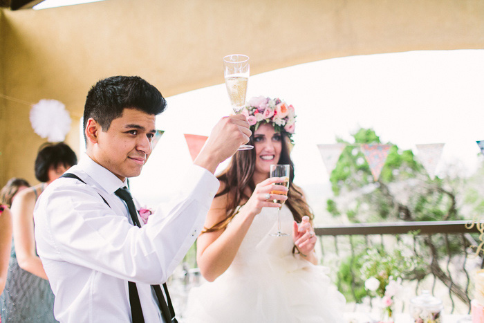 bride and groom raising their glasses