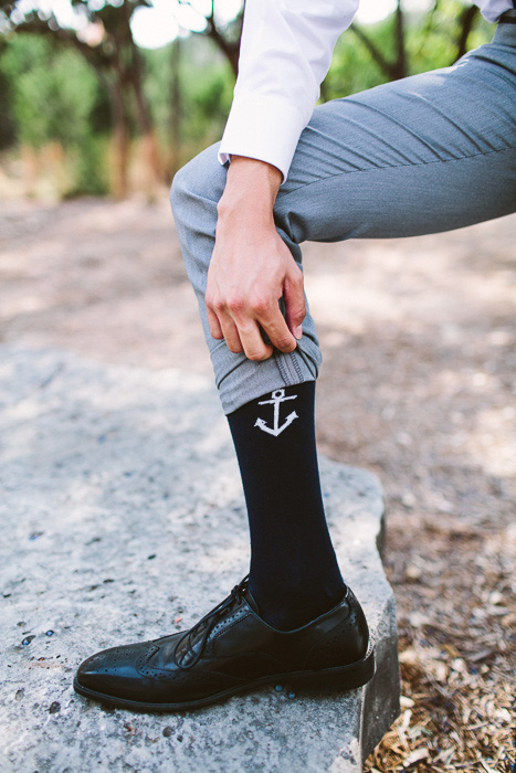 groom wearing anchor socks