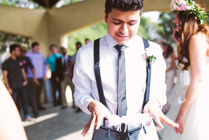 groom getting ready to toss the garter