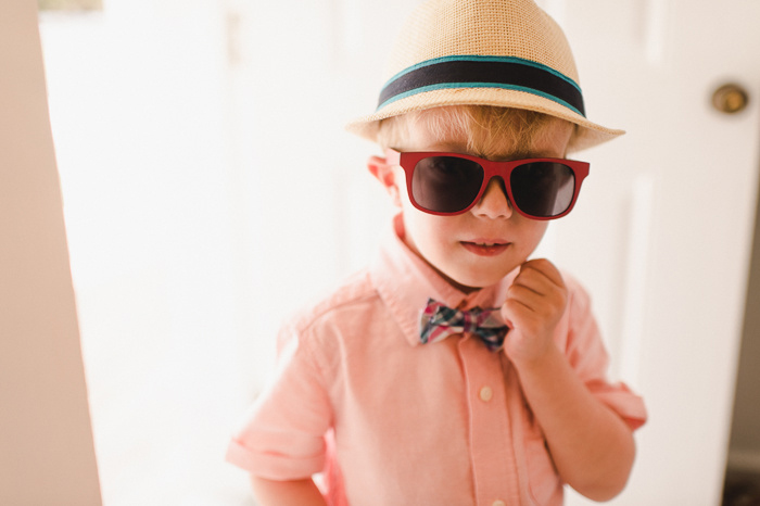 ring bearer in bow tie and wayfarers