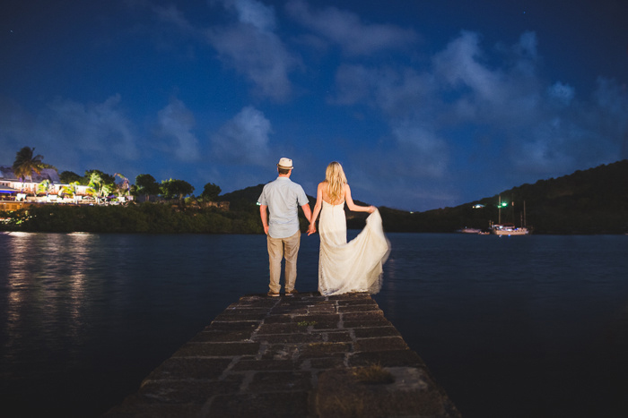 Bride and groom on dock in Antigua