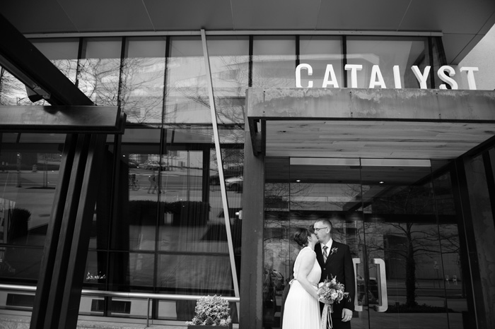 bride and groom outside Catalyst restaurant
