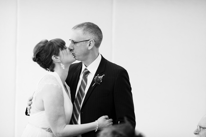 bride and groom kissing at reception