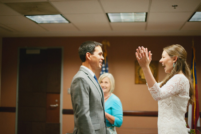 excited bride at courthouse ceremony