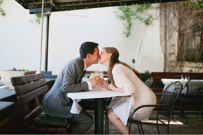eloping couple kissing over cupcakes