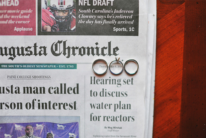 wedding rings on newspaper