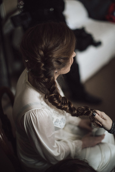 bride having her hair braided