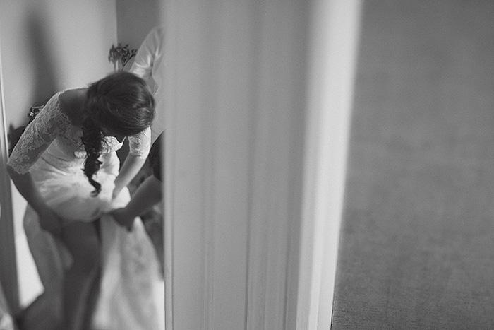 bride adjusting her garter
