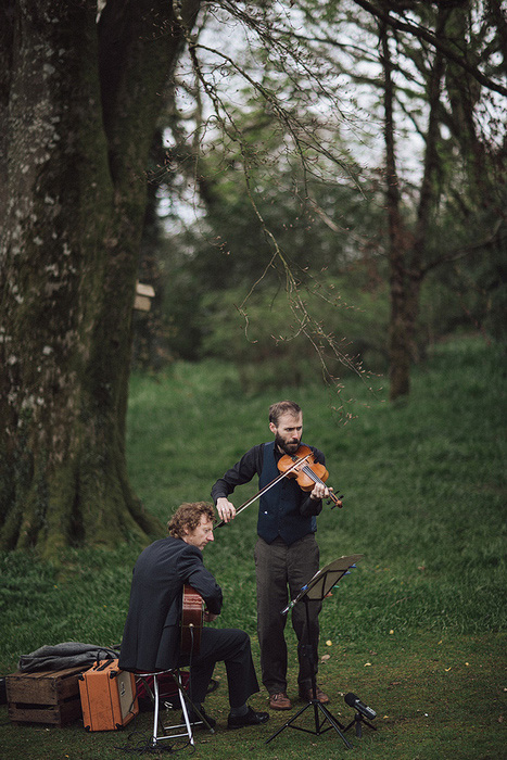 violinist at outdoor wedding wedding ceremoy