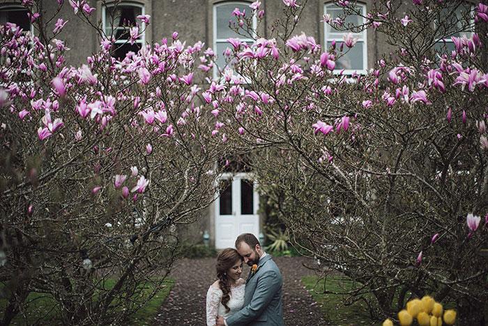 bride and groom outside irish inn