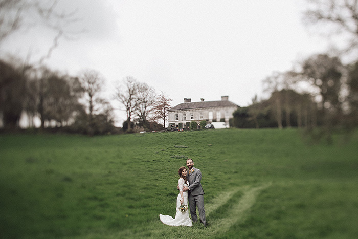 bride and groom on country inn grounds