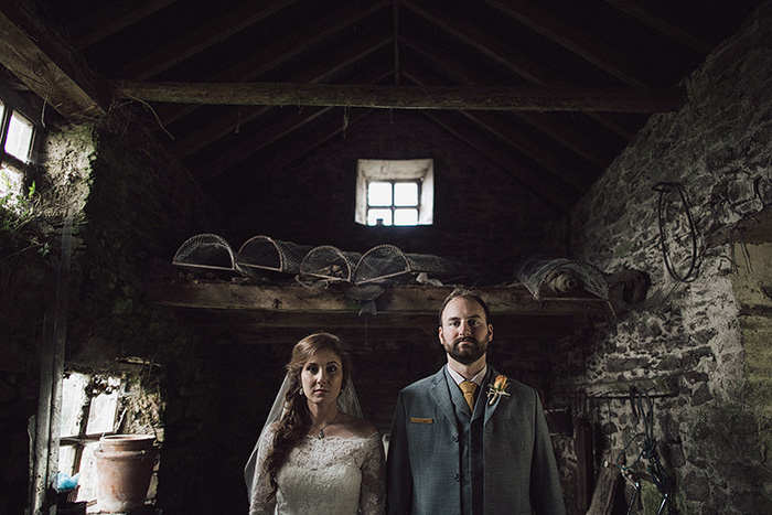 bride and groom in stone shed