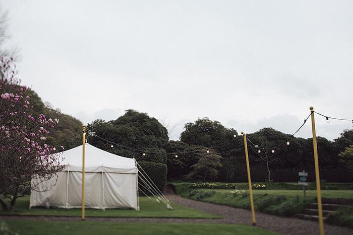 wedding tent set up on irish country house grounds