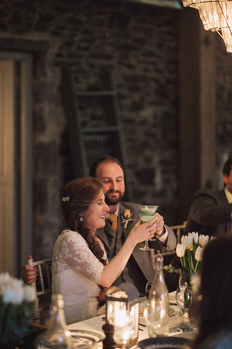 bride and groom toasting with martinis