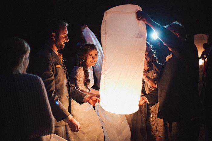 bride and groom releasing a wish lantern