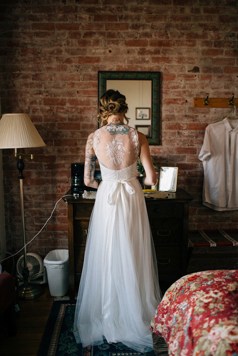 bride in lace backed dress