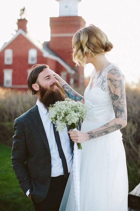 bride fixing groom's hair