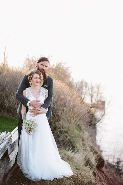 groom embracing bride from behind