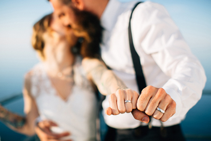 bride and groom fists with rings