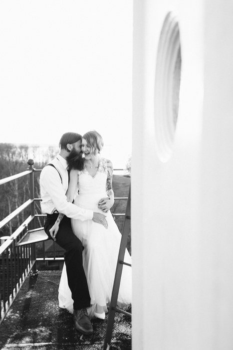 bride and groom lighthouse portrait