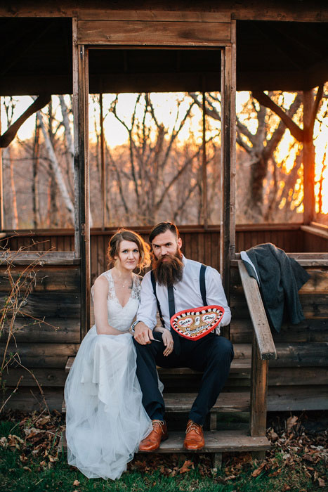 bride and groom with large heart shaped cookie