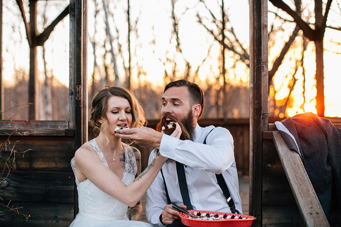 bride and groom eating cookie