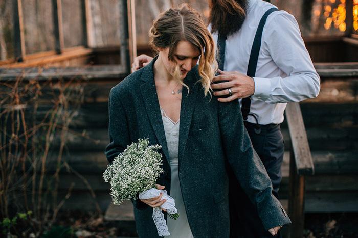 bride wearing groom's jacket