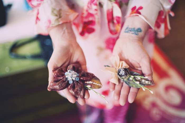 bride holding brooches
