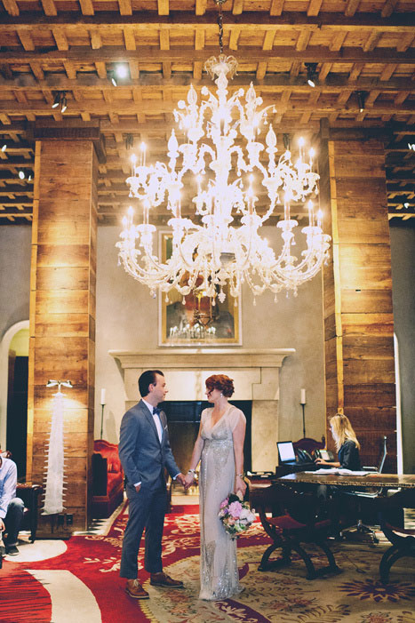 bride and groom in grand hotel lobby