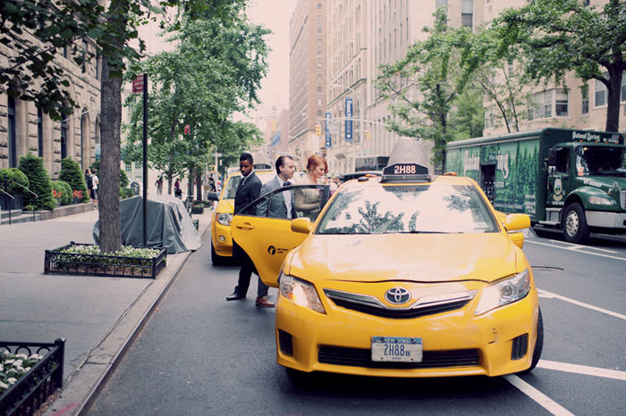 groom getting into yellow taxi