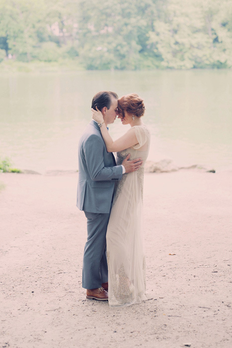 bride and groom by lake in Central Park