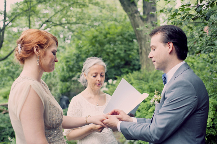 groomputting ring on bride's finger