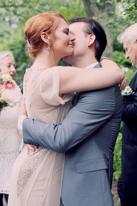 bride and groom hugging after first kiss