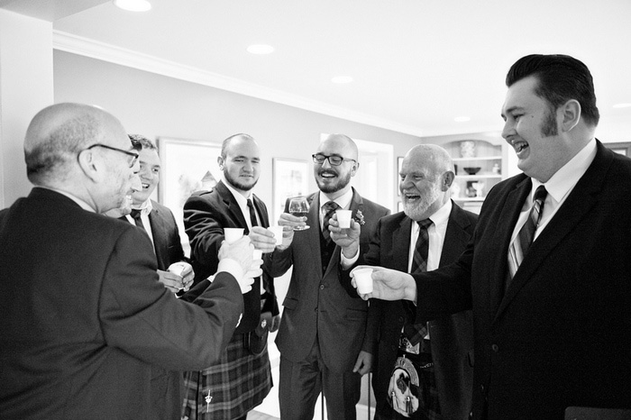 groom toasting with bridal party