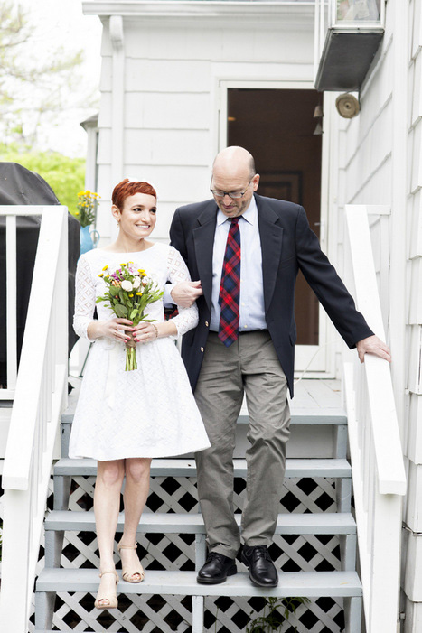 bride walking down steps with her father