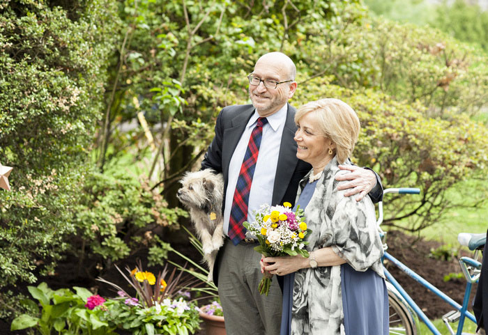 parents at backyard wedding ceremony