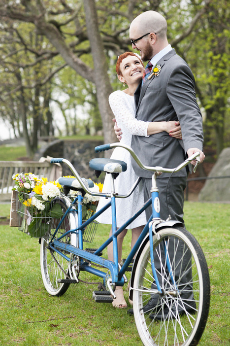 bride and groom with tandem bicycle