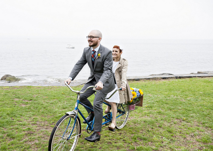 brie and groom riding tandem bike