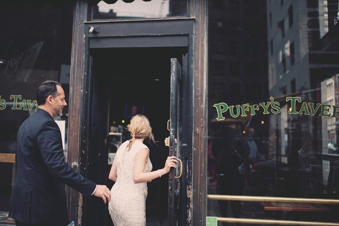 bride and groom entering NYC pub