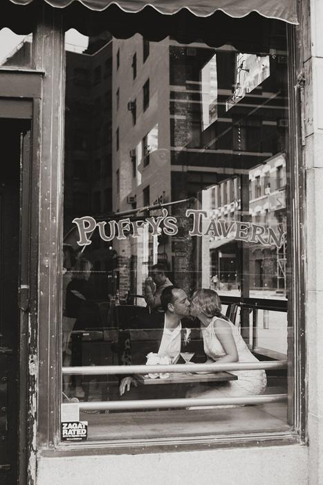 bride and groom in pub window