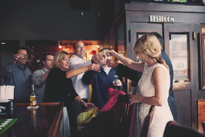 bride and groom toasting with pub patrons